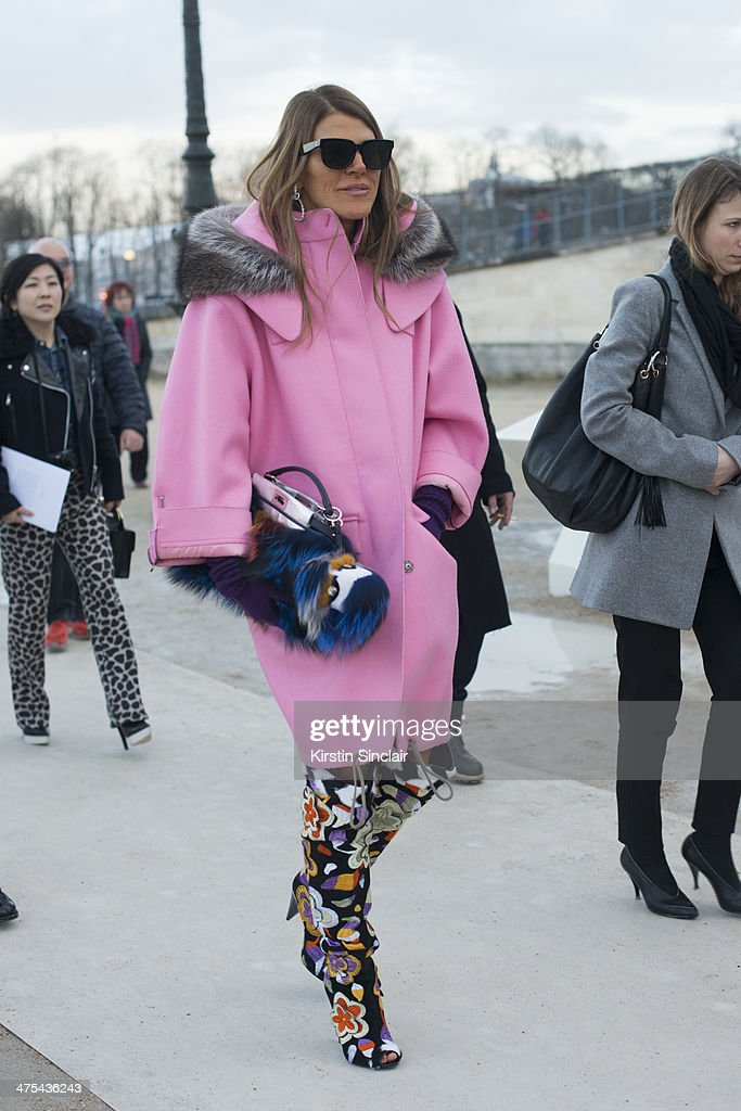 Editor-at-large and Creative Consultant for Vogue Japan Anna Dello Russo wears a Fendi bag and fendi Monster, Miu Miu coat and sunglasses on day 3 of Paris Collections: Women on February 27, 2014 in Paris, France.