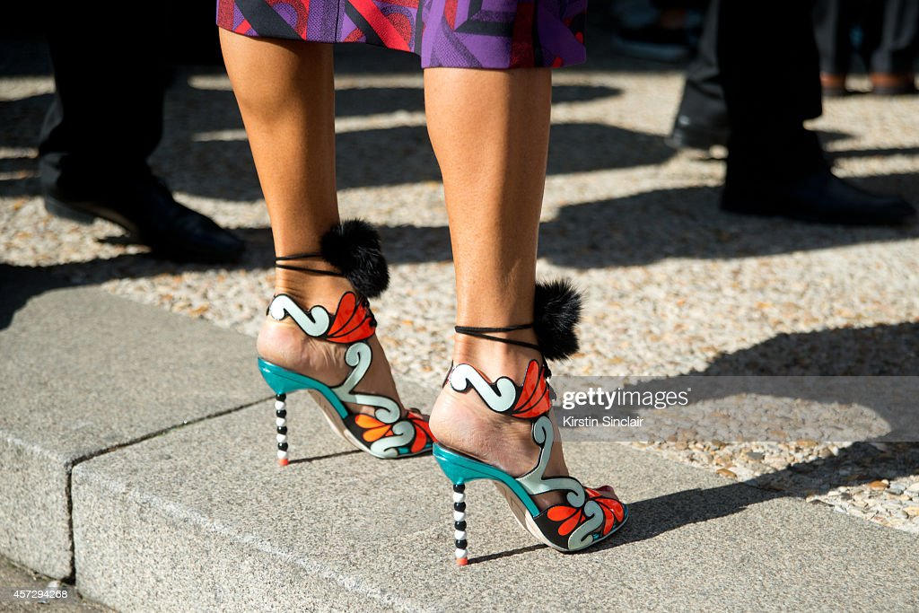 Editoratlarge and Creative Consultant for Vogue Japan Anna Dello Russo is wearing Sofia Webster shoes and Prada dress on day 9 of Paris Collections...