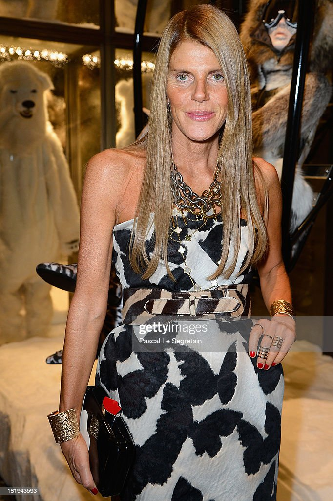 Editor-at-large and creative consultant for Vogue Japan Anna Dello Russo attends the cocktail for the Moncler New Flagship Opening in Paris at Rue Du Faubourg Saint-Honore on September 26, 2013 in Paris, France.