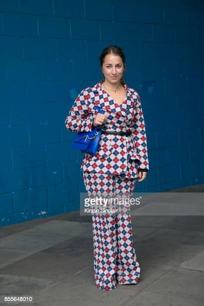 Editorial director at Who What Wear UK Hannah Almassi wears a vintage suit and a Sophie Hulme bag on day 2 of London Womens Fashion Week...