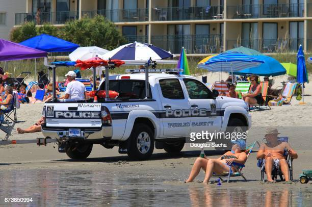 Editorial - Life Guard vehicle patrols the Beach, North Myrtle Beach, South Carolina, USA