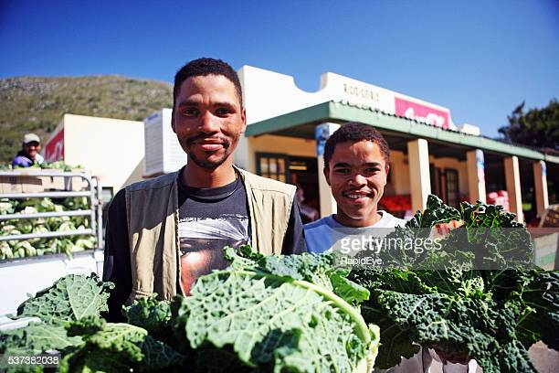 editorial, workers, greengrocer, vegetable, kale, store, unloading, outdoors, South Africa,