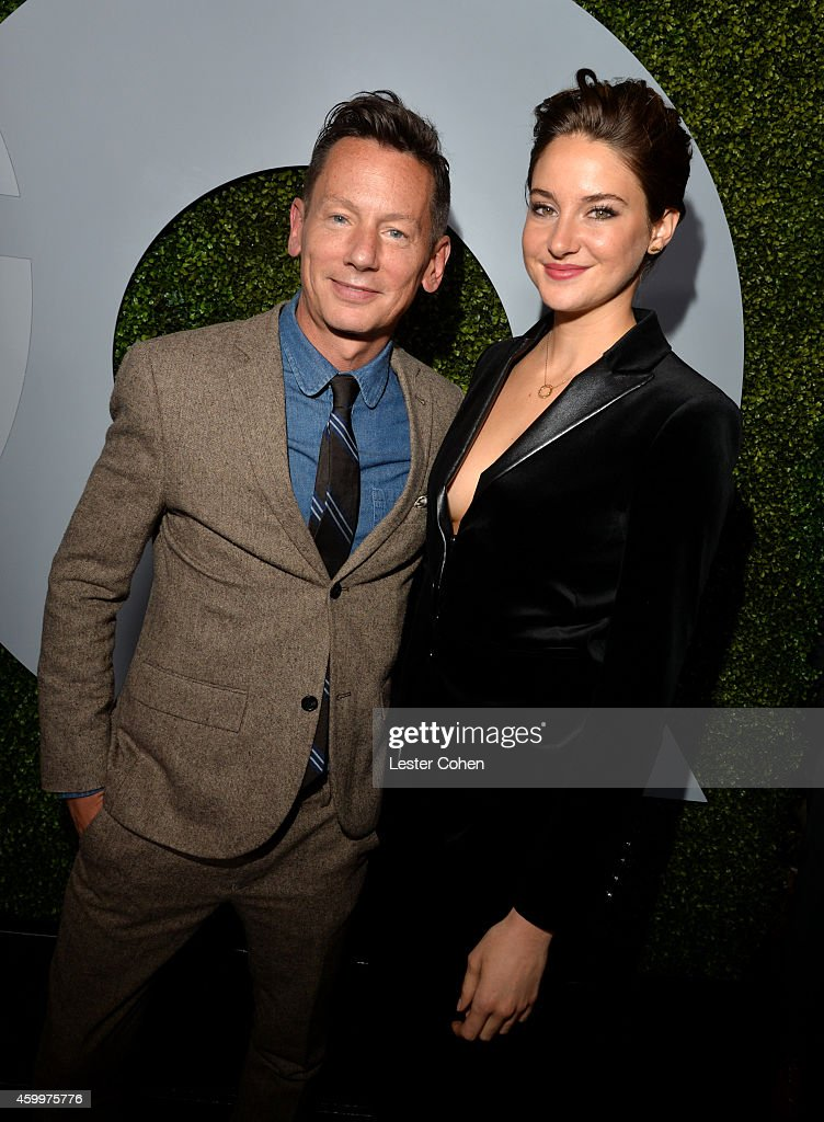 EditorinChief Jim Nelson and actress Shailene Woodley attend the 2014 GQ Men Of The Year party at Chateau Marmont on December 4 2014 in Los Angeles...