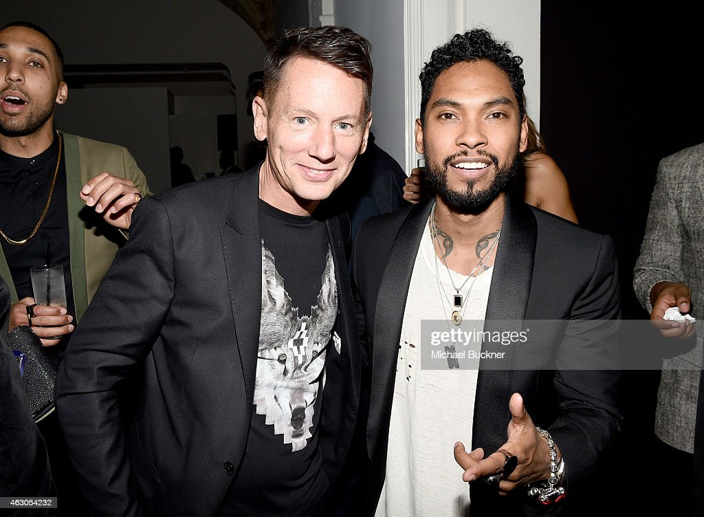 EditorinChief Jim Nelson and recording artist Miguel attend GQ and Giorgio Armani Grammys After Party at Hollywood Athletic Club on February 8 2015...