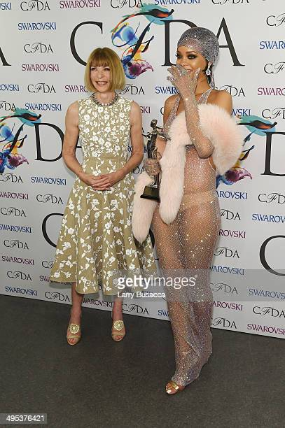 Editorinchief of American Vogue Anna Wintour and Fashion Icon award recipient Rihanna attend the winners walk during the 2014 CFDA fashion awards at...