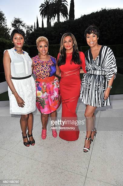 EditorinChief of Ebony Kierna Mayo chairman of JPC Linda Johnson Rice fashion designer Tina Knowles Lawson and Ebony CEO Desiree Rogers attend a...