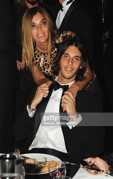 Editorinchief of French Vogue Carine Roitfeld and Vladimir RestoinRoitfeld attends amfAR's Cinema Against AIDS 2010 benefit gala dinner at the Hotel...