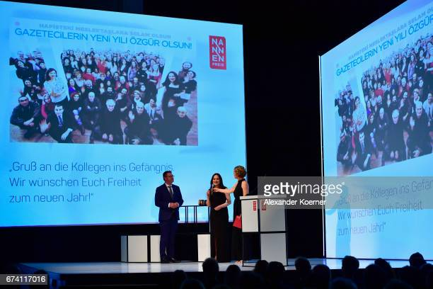 Editorinchief of Stern Magazine Christian Krug Turkish journalist Banu Gueven and Caren Miosga seen on stage at the Nannen Award 2017 on April 27...
