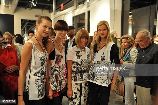 Editorinchief of US Vogue Anna Wintour poses for photographs with models at Fashion's Night Out at Theory on September 10 2009 in New York City
