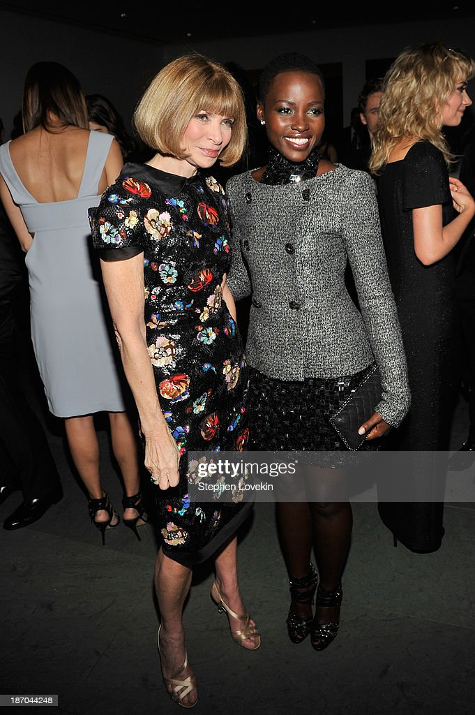 Editor-in-Chief of Vogue Magazine <a gi-track='captionPersonalityLinkClicked' href=/galleries/search?phrase=Anna+Wintour&family=editorial&specificpeople=202210 ng-click='$event.stopPropagation()'>Anna Wintour</a> and actress <a gi-track='captionPersonalityLinkClicked' href=/galleries/search?phrase=Lupita+Nyong%27o&family=editorial&specificpeople=10961876 ng-click='$event.stopPropagation()'>Lupita Nyong'o</a> attend The Museum of Modern Art Film Benefit: A Tribute to Tilda Swinton reception at Museum of Modern Art on November 5, 2013 in New York City.