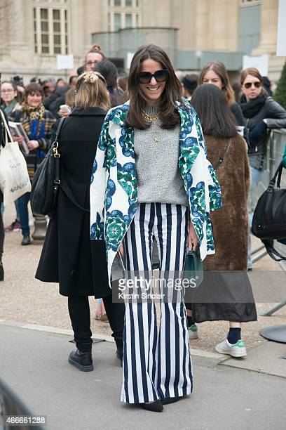 Editorinchief of Vogue Mexico and Latin America Kelly Talamas wears a Polite coat Chanel sunglasses Mixed trousers Vince top Emporio Armarni shoes...