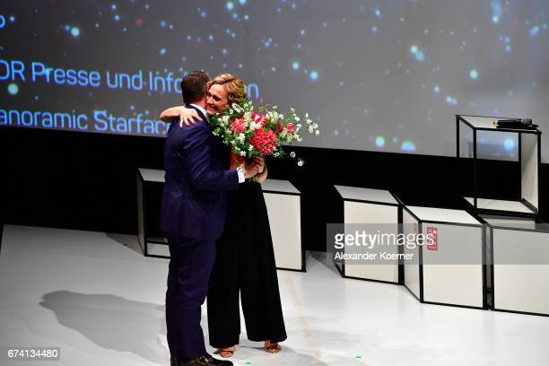 Editorinchief Stern Magazine Christian Krug and Caren Miosga on stage at the Nannen Award 2017 on April 27 2017 in Hamburg Germany