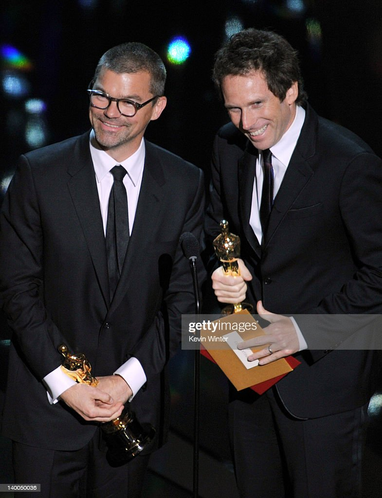 Editors Angus Wall (L) and Kirk Baxter accept the Best Film Editing Award for 'The Girl with the Dragon Tattoo' onstage during the 84th Annual Academy Awards held at the Hollywood & Highland Center on February 26, 2012 in Hollywood, California.