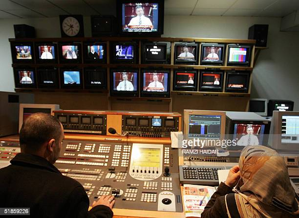Editors are seen at work 07 December 2004 at the control room of AlManar television station mouthpiece of the Lebanese Shiite Muslim militant group...