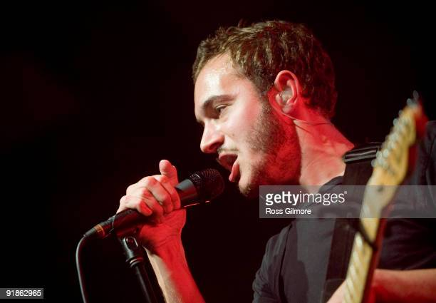 Editors lead singer Tom Smith performs on stage at Barrowlands Ballroom on October 13 2009 in Glasgow Scotland