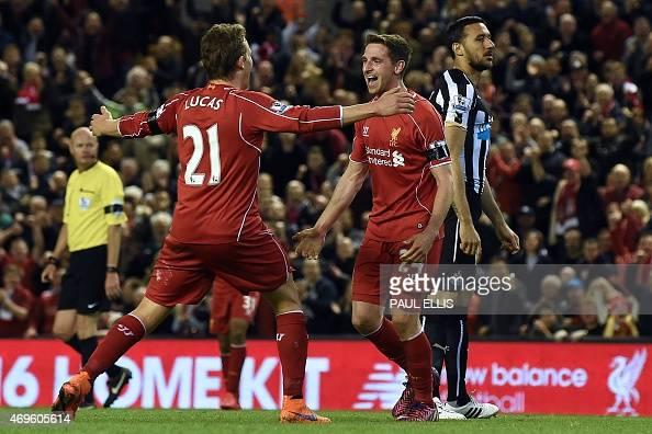 **CORRECTION NB editors Lucas not Henderson ** Liverpool's Welsh midfielder Joe Allen celebrates with Liverpool's Brazilian midfielder Lucas Leiva...
