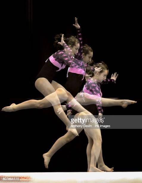 **Editor's Note image created using nikon's inbuilt multi exposure setting** Bulgaria's Viktoriya Georgieva competes on the beam during the Women's...