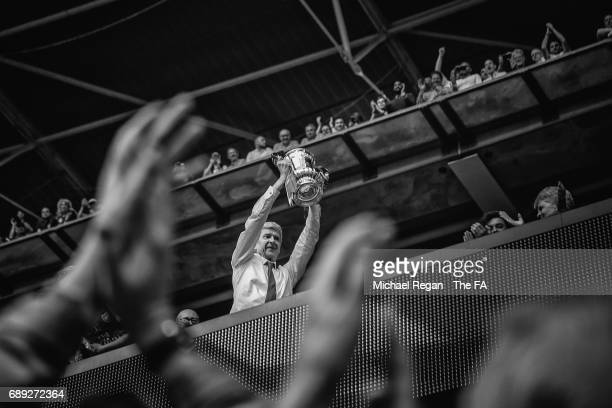 [Editors note This image has been converted into black and white] Arsene Wenger Manager of Arsenal celebrates with The FA Cup after the Emirates FA...