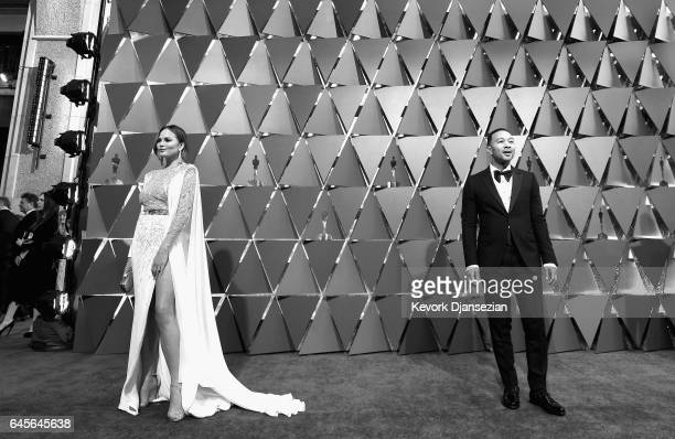 [Editor's note This image has been converted to black and white] Model Chrissy Teigen and musician John Legend attend the 89th Annual Academy Awards...