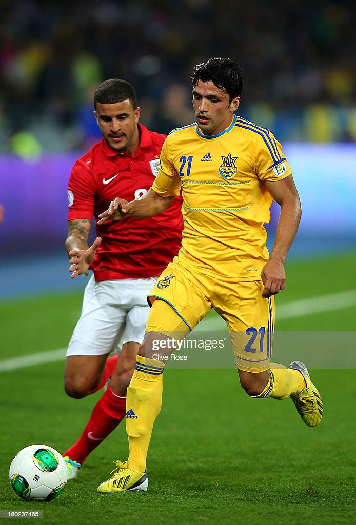 Edmar of Ukraine is pursued by Kyle Walker of England during the FIFA 2014 World Cup Qualifying Group H match between Ukraine and England at the Olympic Stadium on September 10, 2013 in Kiev, Ukraine.