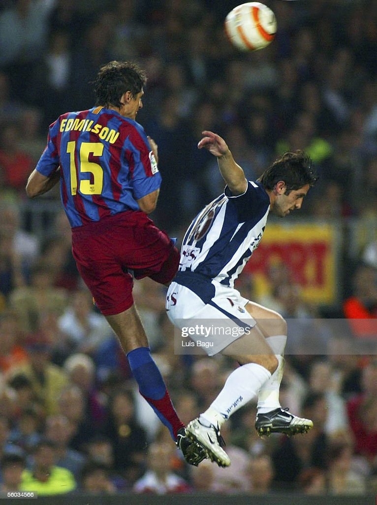 Edmilson of FC Barcelona and Nihat of Real Sociedad compete the ball in the air during the La Liga match between FC Barcelona and Real Sociedad, on October 30, 2005 at the Camp Nou stadium in Barcelona, Spain.