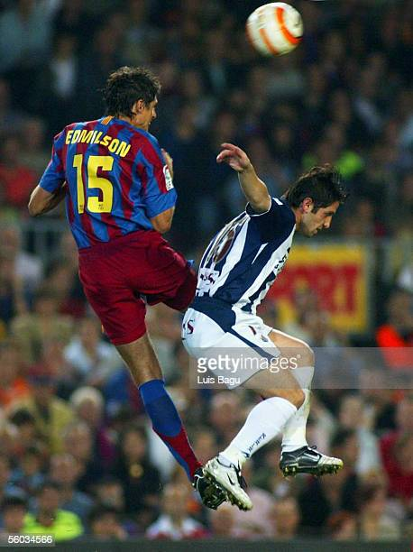 Edmilson of FC Barcelona and Nihat of Real Sociedad compete the ball in the air during the La Liga match between FC Barcelona and Real Sociedad on...