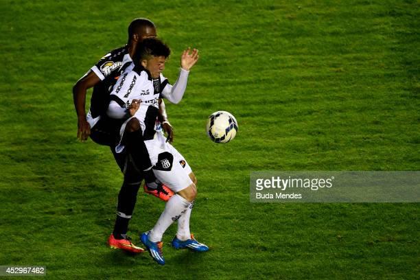 Edmilson of Vasco struggles for the ball with a Rossi of Ponte Preta during a match between Vasco da Gama and Ponte Preta as part of Copa do Brasil...