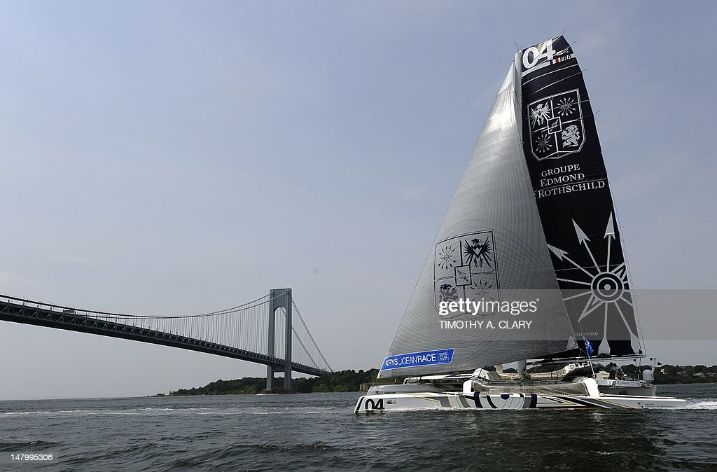 Edmond de Rothschild Group sails towards the Verrazano-Narrows Bridge after the start in the KRYS Ocean Race on July 7, 2012 in New York. Five identical multihull boats took off Saturday from New York in a trans-Atlantic race to the western French city of Brest expected to last about a week.