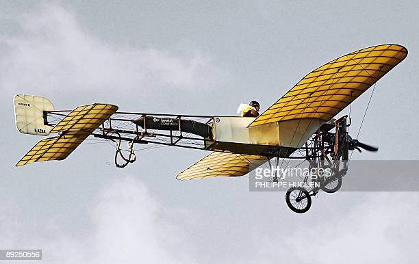 Edmond Salis a French pilot takes off on a 'Bleriot XI' a restored original of the plane in which Louis Bleriot crossed the Channel 100 years ago on...