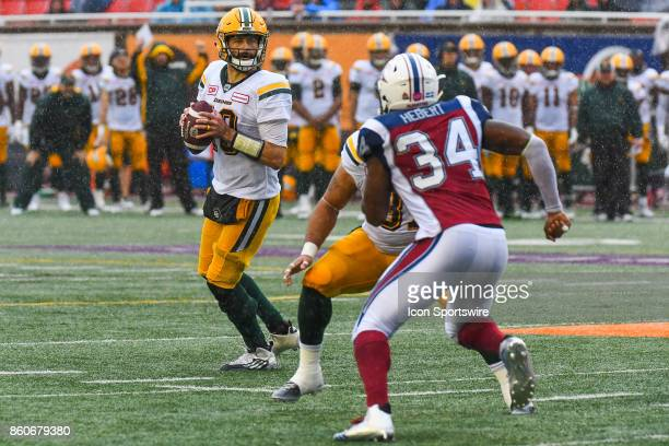 Edmonton Eskimos quarterback Mike Reilly looks for a target to pass the ball during the Edmonton Eskimos versus the Montreal Alouettes game on...