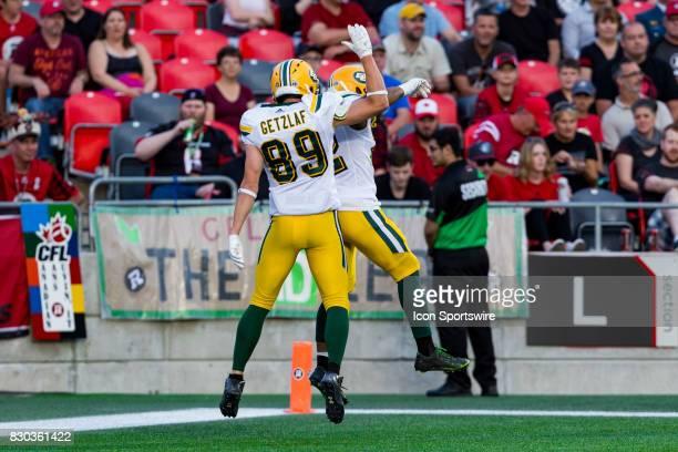 Edmonton Eskimos slotback Chris Getzlaf jumps with running back LaDarius Perkins celebrating his touchdown dduring Canadian Football League action...
