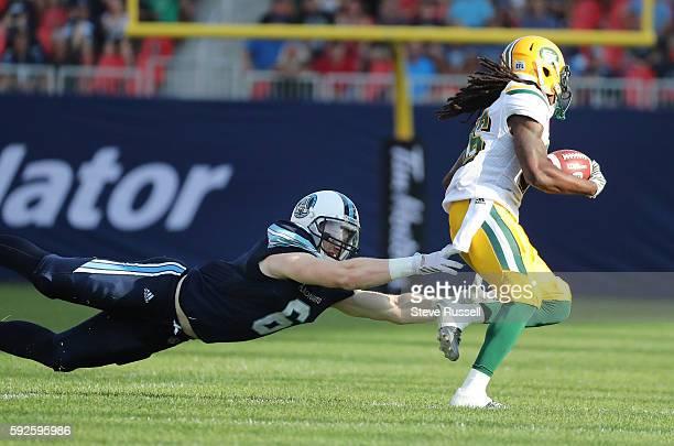 TORONTO ON AUGUST 20 Edmonton Eskimos wide receiver Kenzel Doe slips away from Toronto Argonauts wide receiver Brian Jones Toronto Argonauts play the...