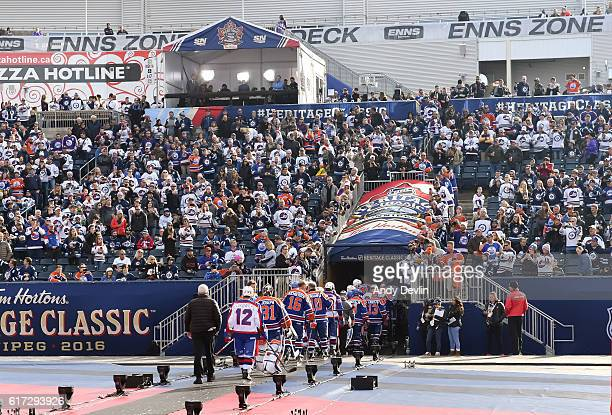 Edmonton Oilers alumni leave the ice after warmup in advance of the 2016 Tim Hortons NHL Heritage Classic alumni game at Investors Group Field on...