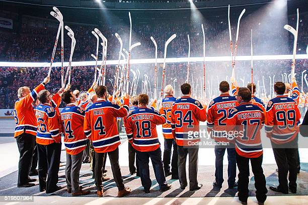 Edmonton Oilers alumni salute the fans during the closing ceremonies at Rexall Place following the game between the Edmonton Oilers and the Vancouver...