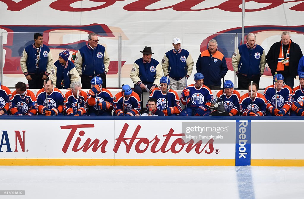 Edmonton Oilers alumni take a break on the bench during the 2016 Tim Hortons NHL Heritage Classic alumni game at Investors Group Field on October 22, 2016 in Winnipeg, Canada.