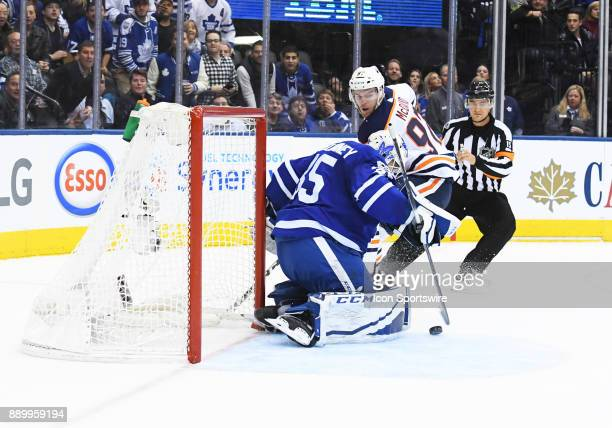 Edmonton Oilers center Connor McDavid is stopped on a break away by Toronto Maple Leafs goalie Curtis McElhinney during the second period in a game...