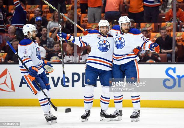 Edmonton Oilers Defenceman Andrej Sekera celebrates with Edmonton Oilers Right Wing Leon Draisaitl and Edmonton Oilers Defenceman Kris Russell after...