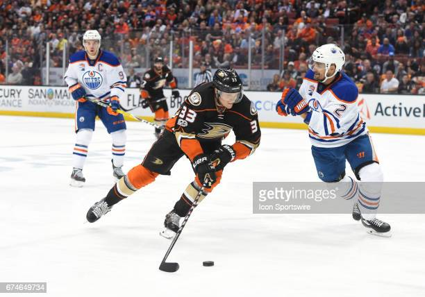 Edmonton Oilers Defenceman Andrej Sekera plays defense without a stick against Anaheim Ducks Right Wing Jakob Silfverberg during game 2 of the second...
