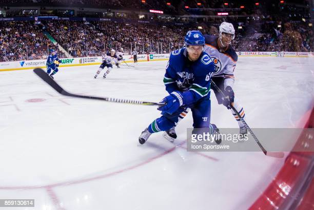 Edmonton Oilers Defenceman Darnell Nurse checks Vancouver Canucks Center Markus Granlund during the Edmonton Oilers game versus the Vancouver Canucks...