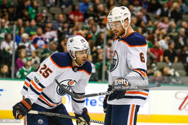 Edmonton Oilers defenseman Adam Larsson and defenseman Darnell Nurse discuss the next play during a timeout during the game between the Dallas Stars...