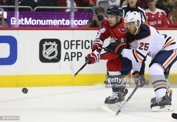 Edmonton Oilers defenseman Darnell Nurse hangs onto Washington Capitals center Evgeny Kuznetsov during a NHL game between the Washington Capitals and...