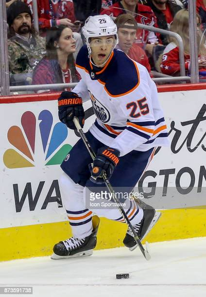 Edmonton Oilers defenseman Darnell Nurse moves the puck from behind the goal during a NHL game between the Washington Capitals and the Edmonton...
