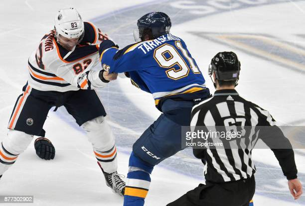 Edmonton Oilers defenseman Matt Benning and St Louis Blues right wing Vladimir Tarasenko fight during a NHL hockey game between the Edmonton Oilers...