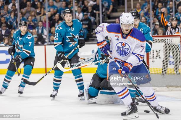Edmonton Oilers defenseman Oscar Klefbom struggles for the puck in front of San Jose Sharks net during the first period of the Round 1 Game 3 between...
