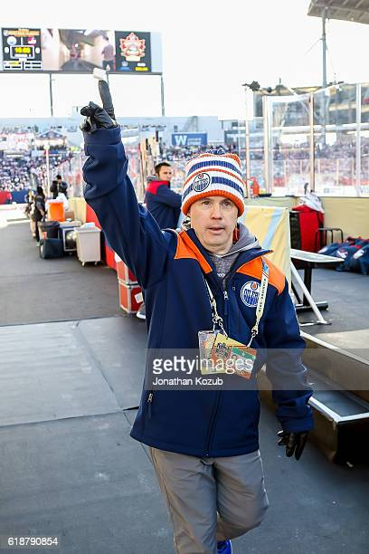 Edmonton Oilers dressing room attendant Joey Moss salutes the crowd as he makes his way to the ice prior to puck drop between the Oilers and the...