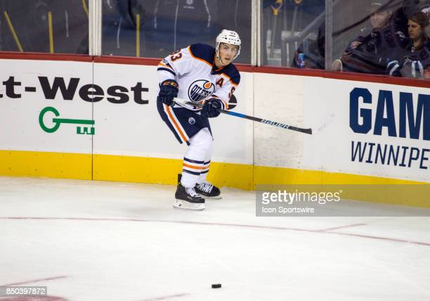 Edmonton Oilers forward Ryan NugentHopkins passes the puck during the NHL game between the Winnipeg Jets and the Edmonton Oilers on September 20 2017...