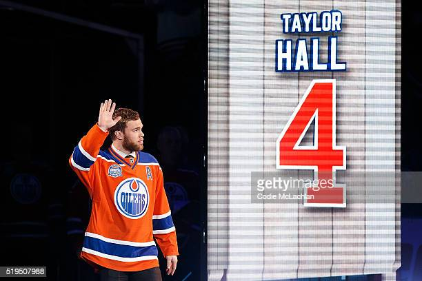 Edmonton Oilers forward Taylor Hall greets fans during the closing ceremonies at Rexall Place following the game between the Edmonton Oilers and the...