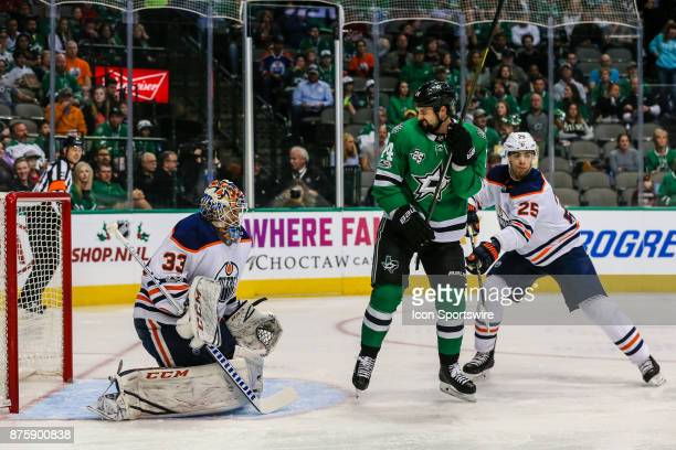 Edmonton Oilers goalie Cam Talbot blocks a shot with Dallas Stars left wing Jamie Benn and Edmonton Oilers defenseman Darnell Nurse battle in front...
