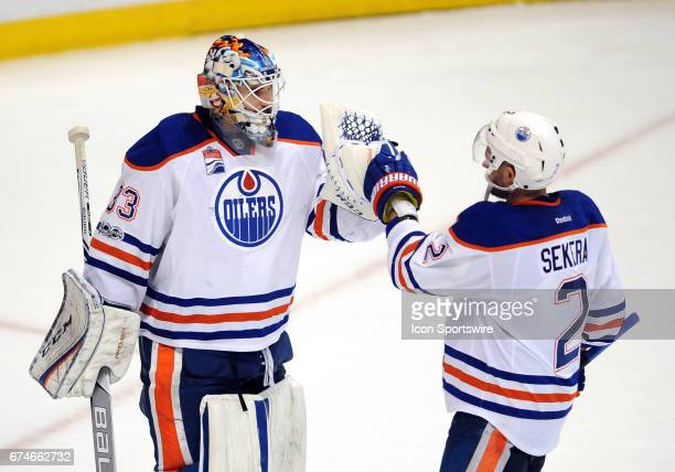 Edmonton Oilers goalie Cam Talbot with defenseman Andrej Sekera after the Oilers defeated the Anaheim Ducks 2 to 1 on April 28 2017 during game 2 of...