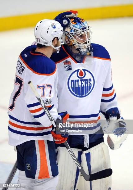 Edmonton Oilers goalie Cam Talbot with defenseman Oscar Klefbom on the ice after the Oilers defeated the Anaheim Ducks 5 to 3 in game 1 of the second...